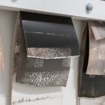 """Mantra #3"" (detail 1); Silver gelatin photographic chemigrams, wood, metal; 20"" x 39"" x 3""; 2019"