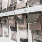 """Mantra #3"" (detail 2); Silver gelatin photographic chemigrams, wood, metal; 20"" x 39"" x 3""; 2019"