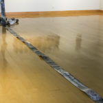 """""""Small Hiccup""""; Silver gelatin photographic chemigrams, thread; 5"""" x approx. 120' (dimensions variable); 2015; Installed at Contemporary Gallery, Center for Art and Theatre, Georgia Southern University, Statesboro Georgia"""