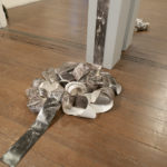 """""""Small Hiccup""""; Silver gelatin photographic chemigrams, thread; 5"""" x approx. 120' (dimensions variable); 2018; Installed at the Gertrude Herbert Institute of Art, Augusta, GA"""